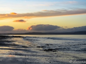 sunset over Moray Firth looking West on an outgoing tide