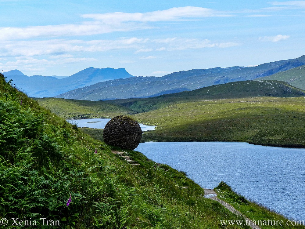 view west from Knockan Crag with the Globe sculpture in the foreground
