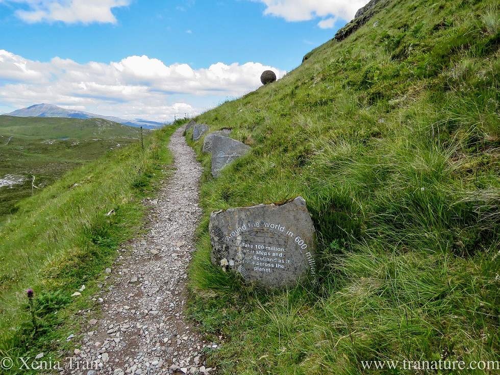 the trail at Knockan Crag with history depicted on painted stones