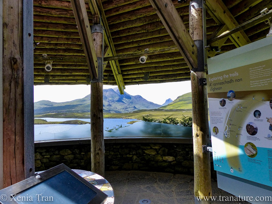 Part of the interior of the Rock Room at Knockan Crag Nature Reserve with the views through the open windows beyond