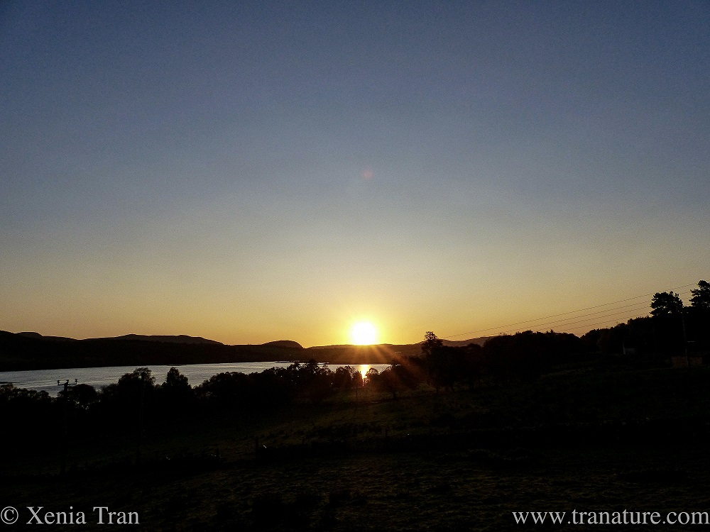 the sun almost risen above the mountains on the opposite shore of the Kyle