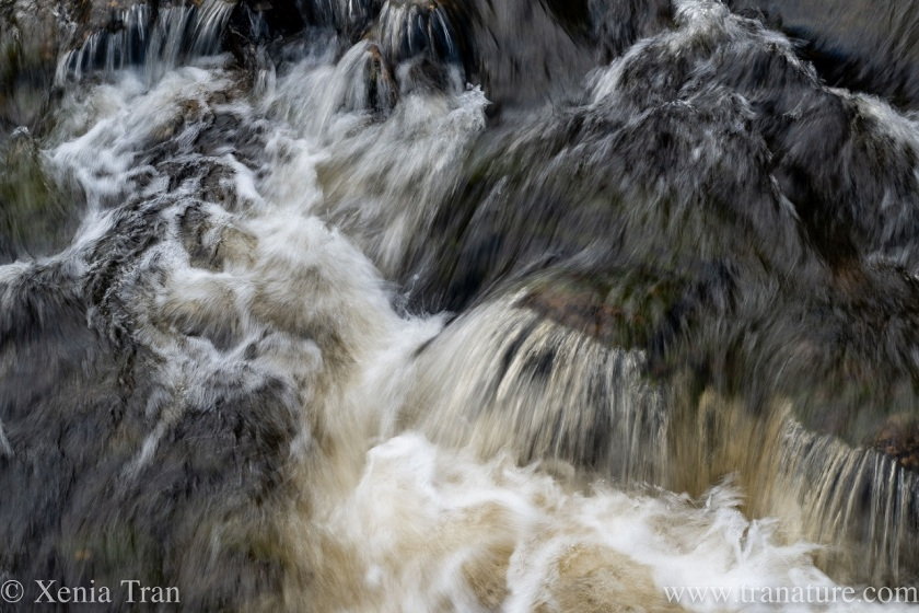 a waterfall photographed with a slow shutter speed